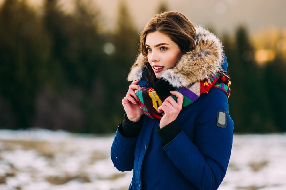 Young Smiling Girl in her Winter Warm Clothing