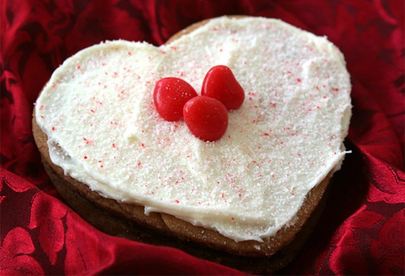 heart shaped cookie on red background
