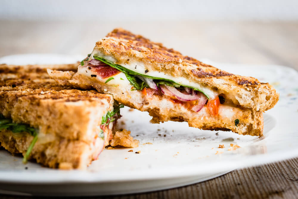Close-up of vegetarian panini with tomatoes and mozzarella