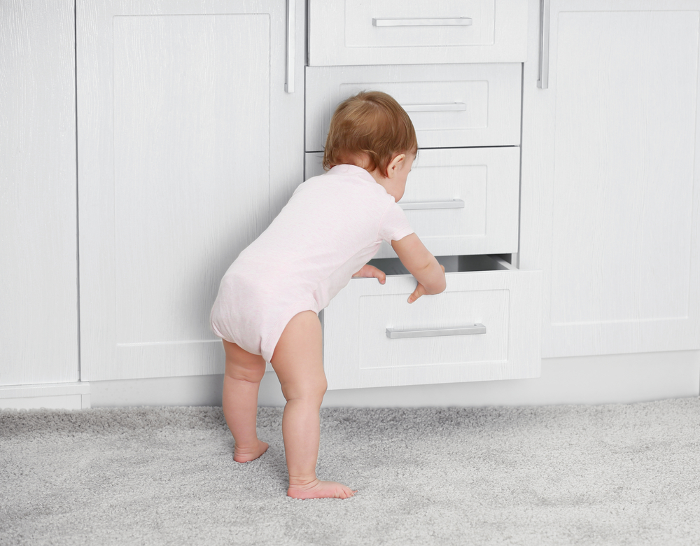baby playing with drawer