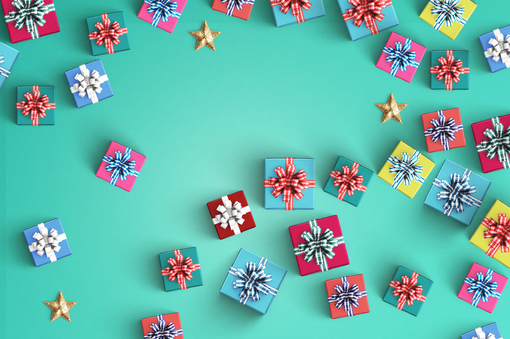 holiday gift boxes on turquoise background