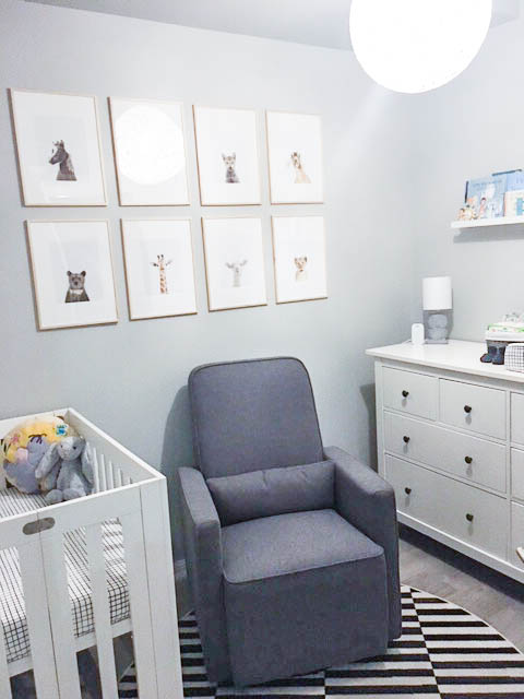 nursery with rocking chair, crib, and other essentials