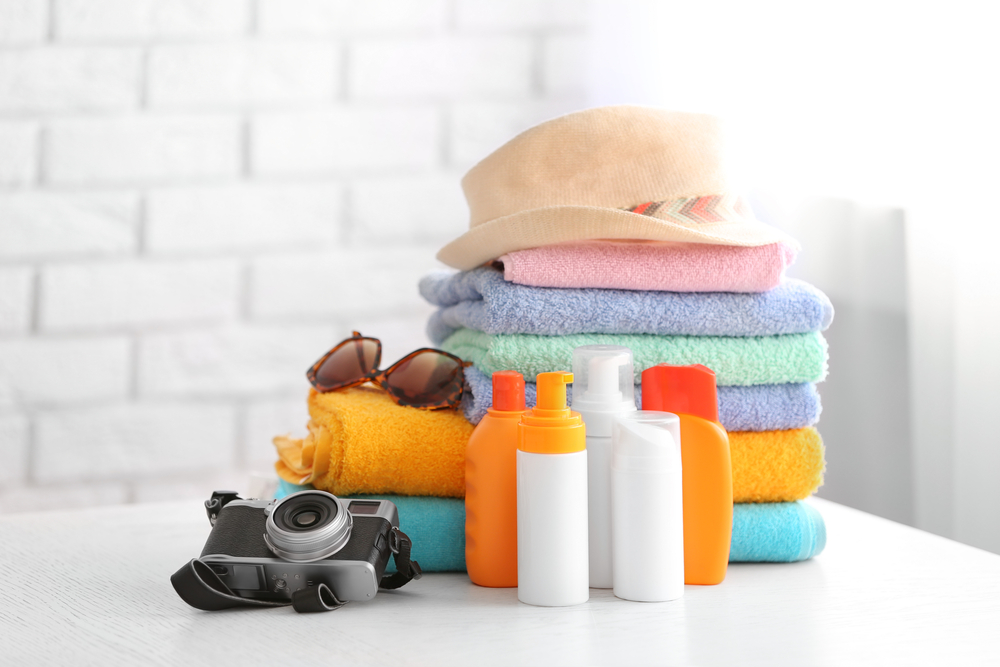 set of summer beach products on table in room