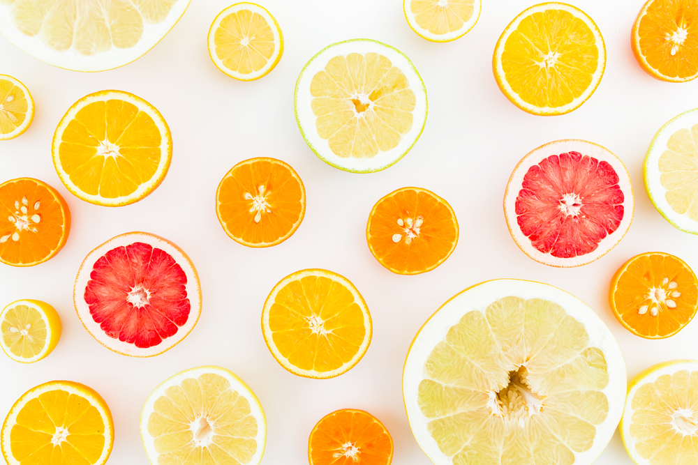 flat lay of citrus fruits including lemon, orange, grapefruit, sweetie and pomelo