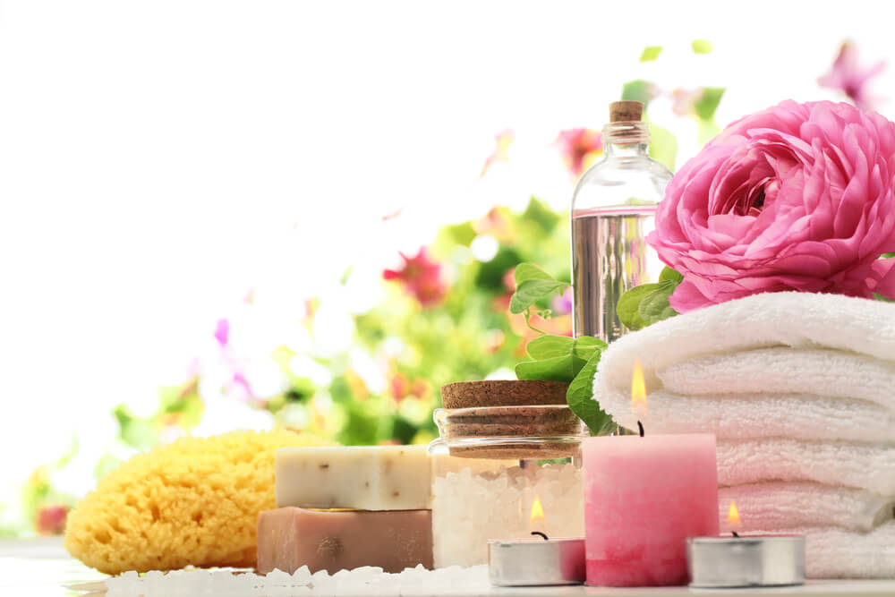 Spa and bath accessories with sponge, soap and towel.