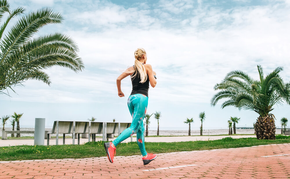 Young woman has an outdoor workout