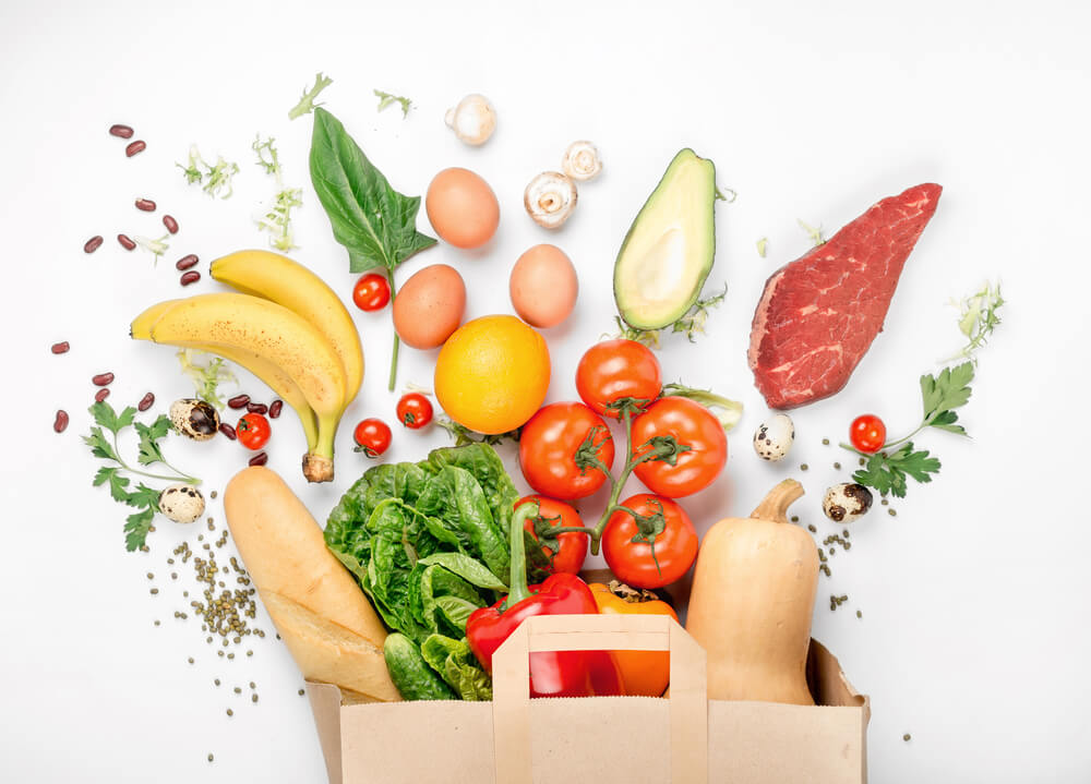 Image of grocery bag full of colourful food