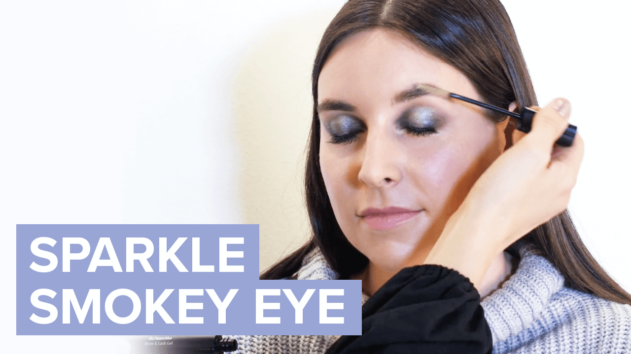 Person getting a smokey makeup look applied