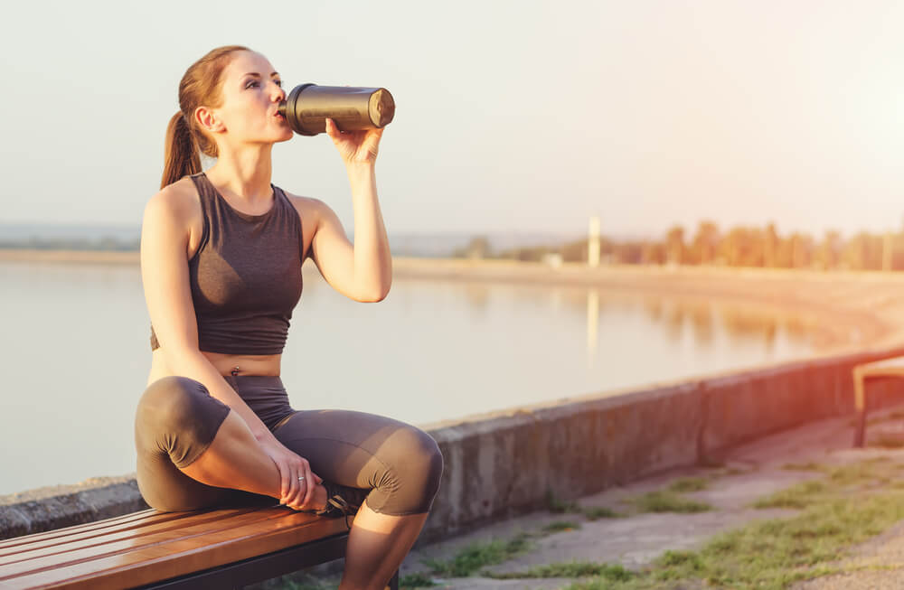 Woman drinking protein shake after workout