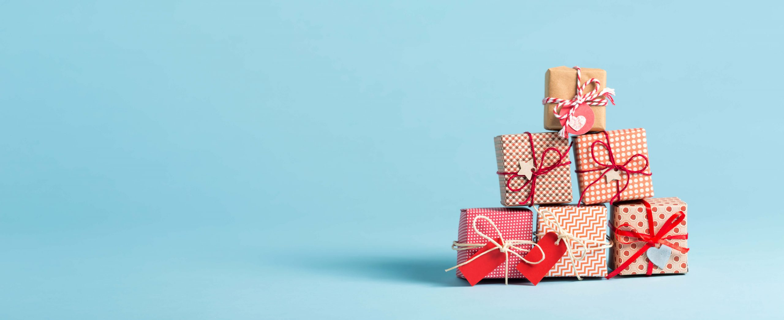 holiday gift stacked on blue background