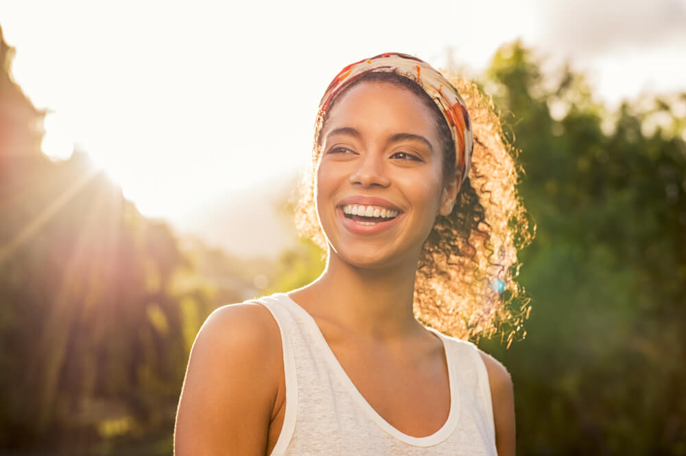 woman smiling on a sunny day