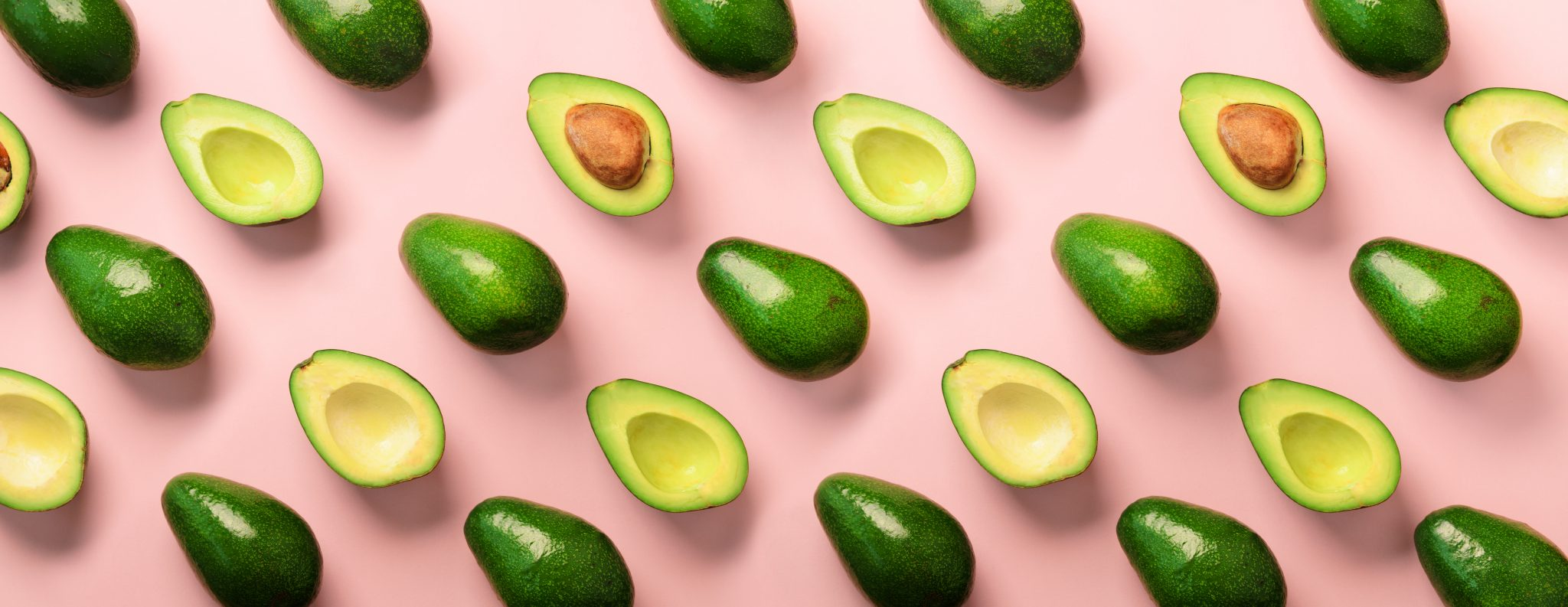 avocados on a pink background
