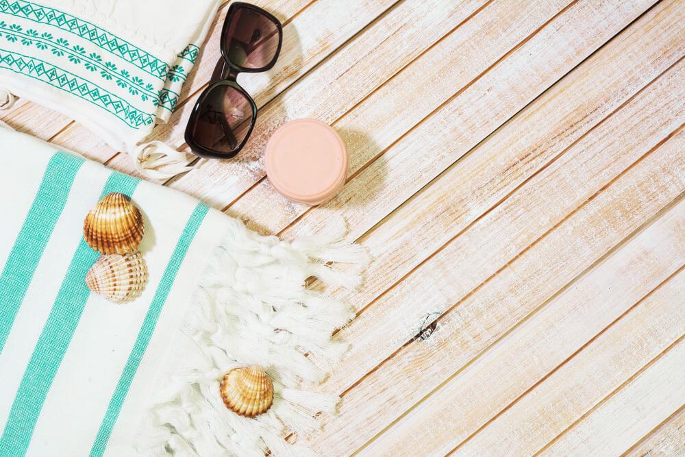 beach essentials on a dock