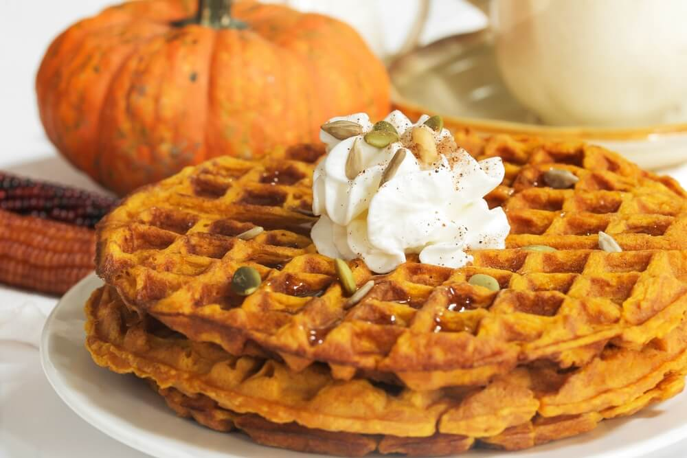 pumpkin waffles with a small pumpkin in the background