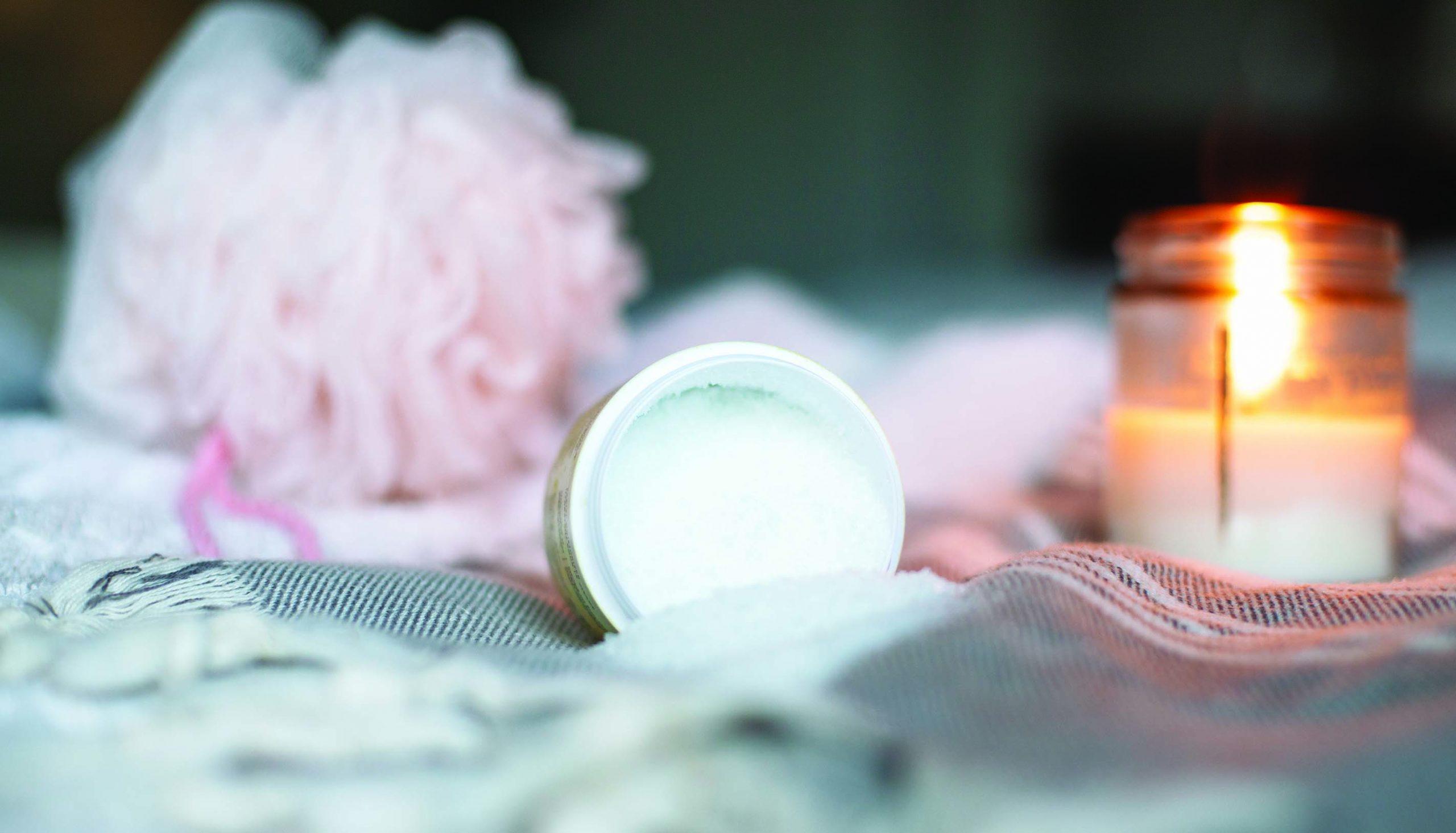 lit candle and loufa