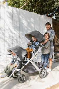 Mom with 3 kids in a stroller